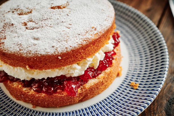 whole victoria sponge cake on a vintage palate. - cake stock pictures, royalty-free photos & images