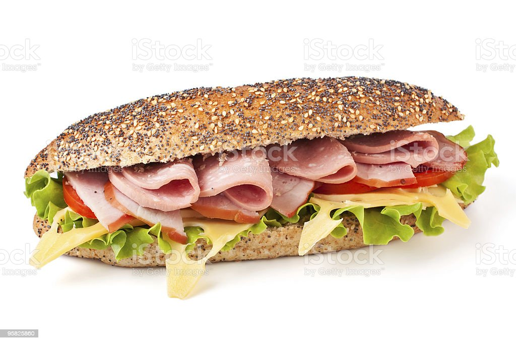Whole wheat baguette with ham, cheese and vegetables stock photo
