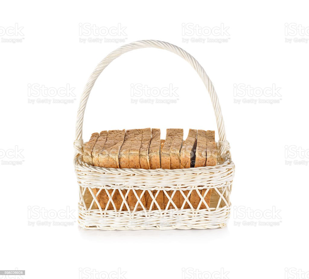 whole wheat bread in white basket on white background foto royalty-free