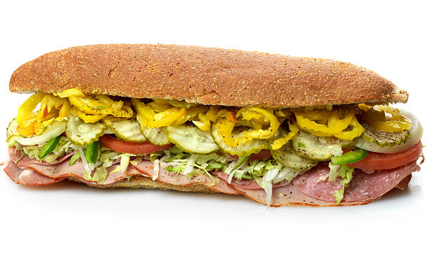 whole wheat bread Italian Submarine Sandwich picture of a whole wheat bread Italian Submarine Sandwich on white background  (picture shot in super high definition with a Hasselblad HD3 II 31 mpx camera) submarine sandwich stock pictures, royalty-free photos & images