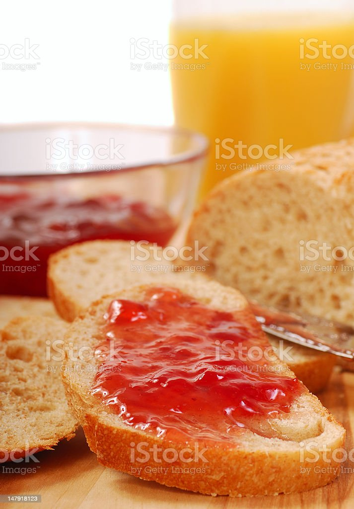Whole wheat bread with strawberry jam royalty-free stock photo