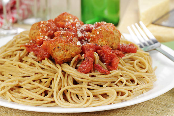 Whole Wheat Pasta Whole wheat multi grain spaghetti and meatballs with a fire roasted tomato sauce whole wheat stock pictures, royalty-free photos & images