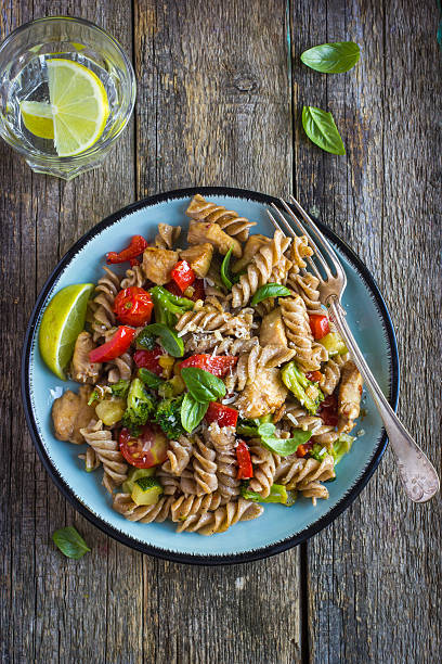 Whole wheat pasta  with chicken and vegetables Whole wheat pasta  with chicken and vegetables, top view whole wheat stock pictures, royalty-free photos & images