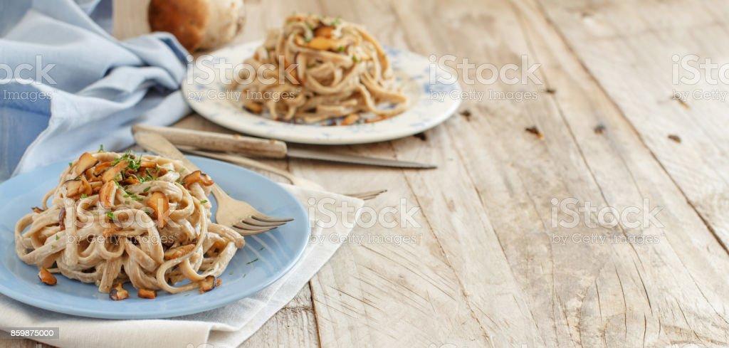 Whole wheat tagliolini with mushrooms Porcini stock photo