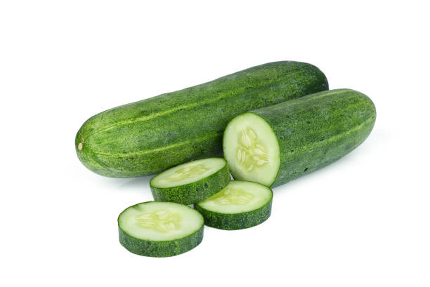 whole with slice cucumber isolated on white background - cucumber stock photos and pictures