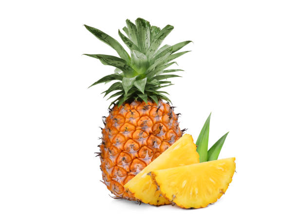 whole with slice ripe pineapple isolated on white background - ananas zdjęcia i obrazy z banku zdjęć