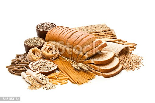 High angle view of wholegrain and cereal composition shot on white background. This type of food is rich of fiber and is ideal for dieting. The composition includes wholegrain sliced bread, wholegrain pasta, oat flakes, flax seed, brown rice, brown lentils, wholegrain crackers, breadsticks and spelt. Predominant colors are brown and white. DSRL studio photo taken with Canon EOS 5D Mk II and Canon EF 100mm f/2.8L Macro IS USM