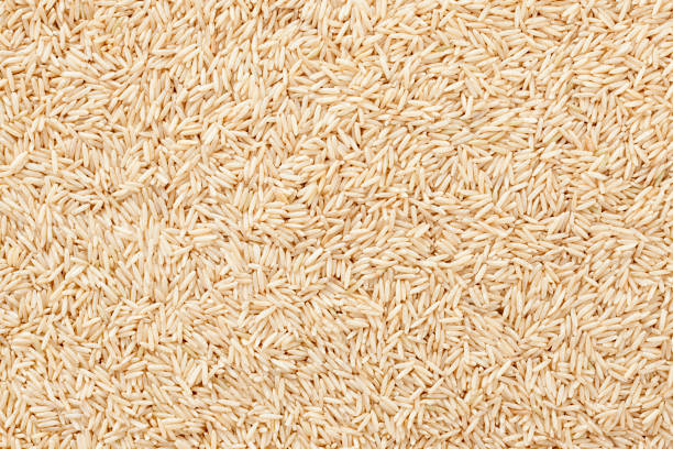 Wholegrain basmati rice background Full frame view of wholegrain basmati rice basmati rice stock pictures, royalty-free photos & images
