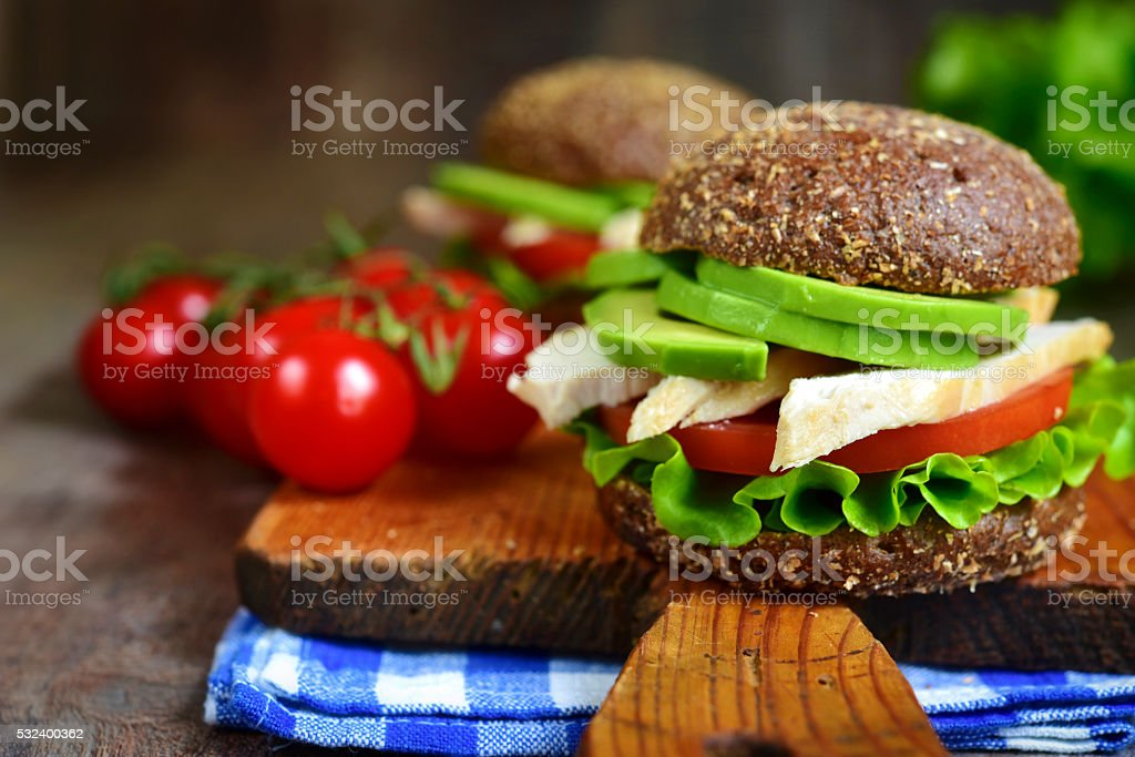 Wholegrain burger with chicken and avocado. stock photo