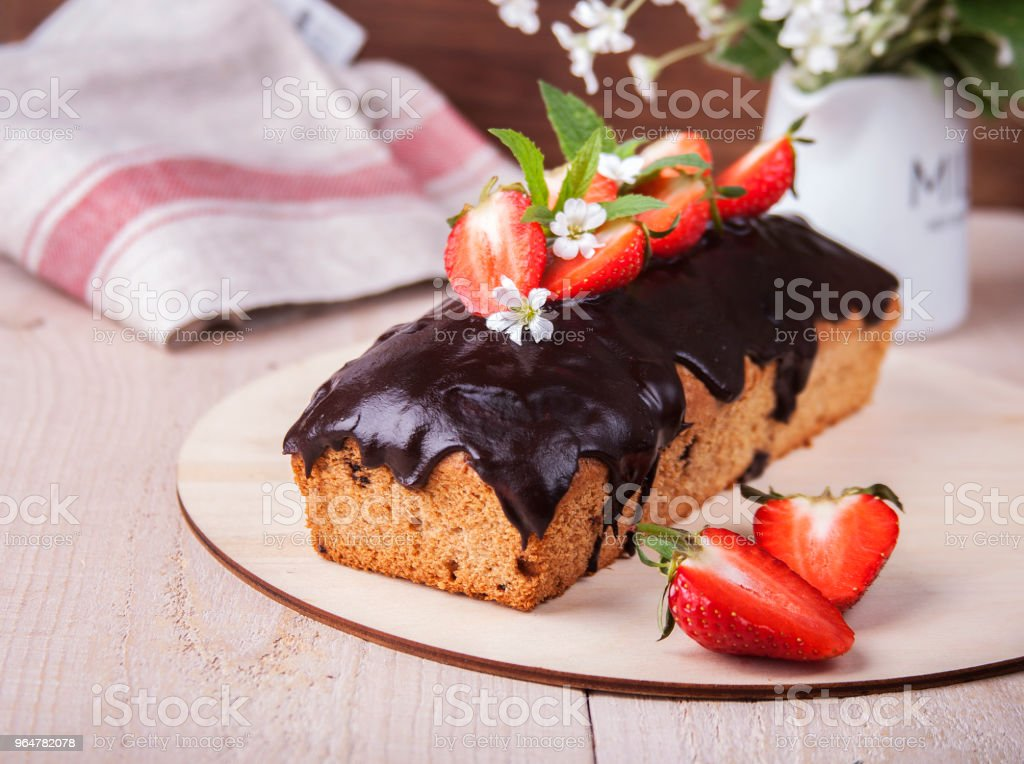 Whole-grain cake with strawberries royalty-free stock photo