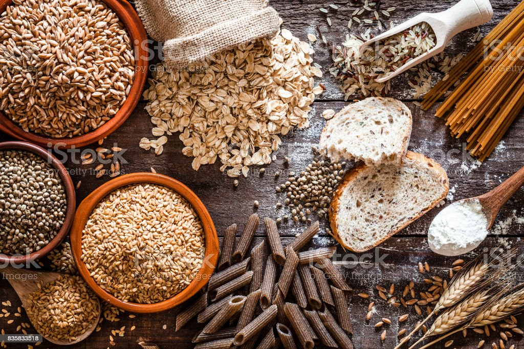 Wholegrain food still life shot on rustic wooden table stock photo