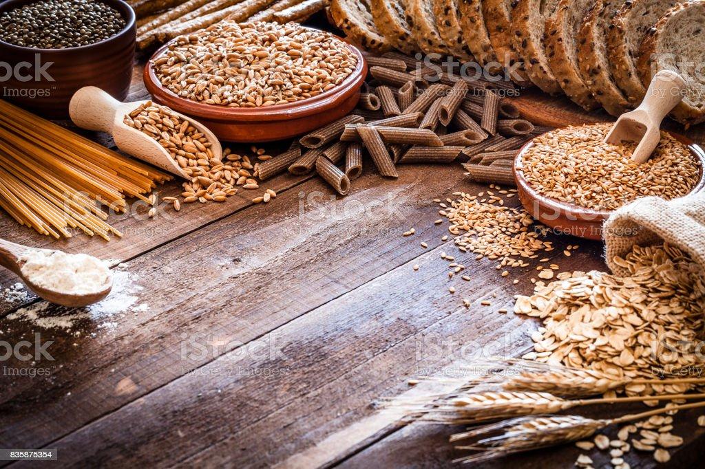 Wholegrain food still life shot on rustic wooden table stock photo