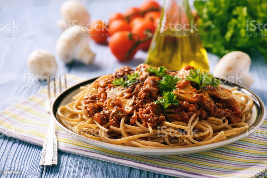 Wholegrain spaghetti with homemade bolognese sauce and mushrooms. stock photo