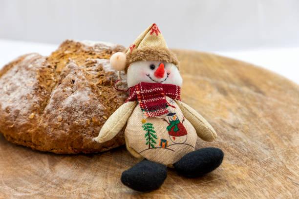 Wholemeal bread Christmas doll snowman stock photo