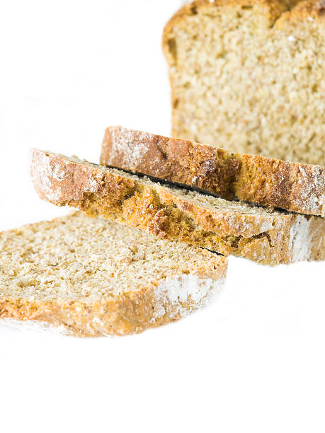 wholemeal bread on white background stock photo