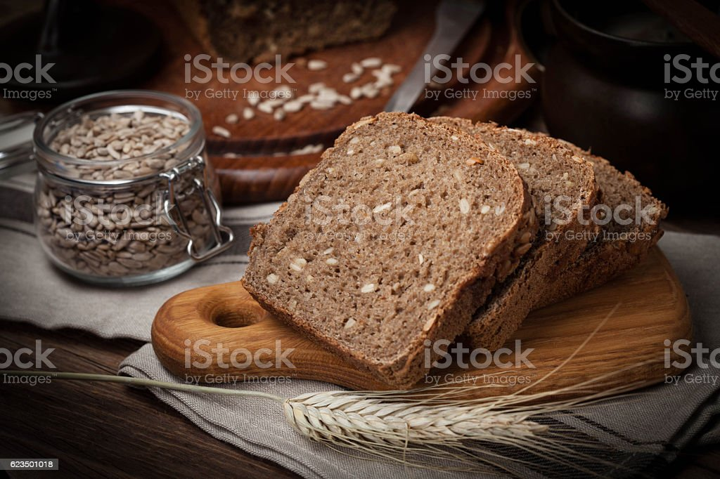 Wholemeal bread with sunflower seeds. stock photo