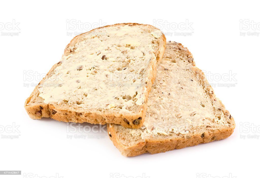 Wholemeal Brown Bread With Butter On A White Background Royalty Free Stock Photo