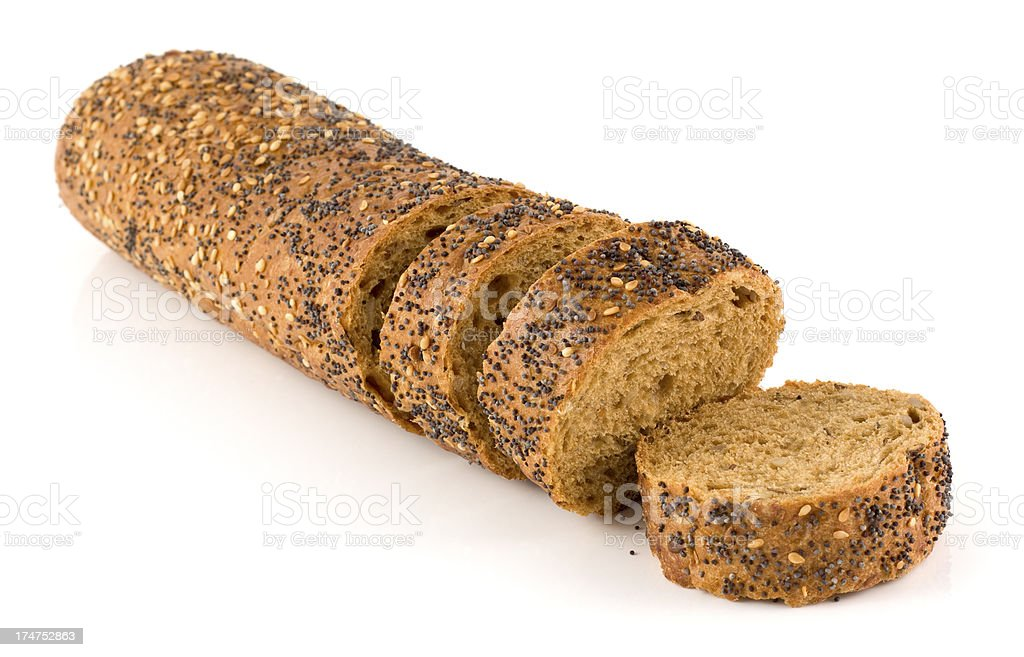 Wholemeal brown sliced multiseeded baguette on a white background stock photo