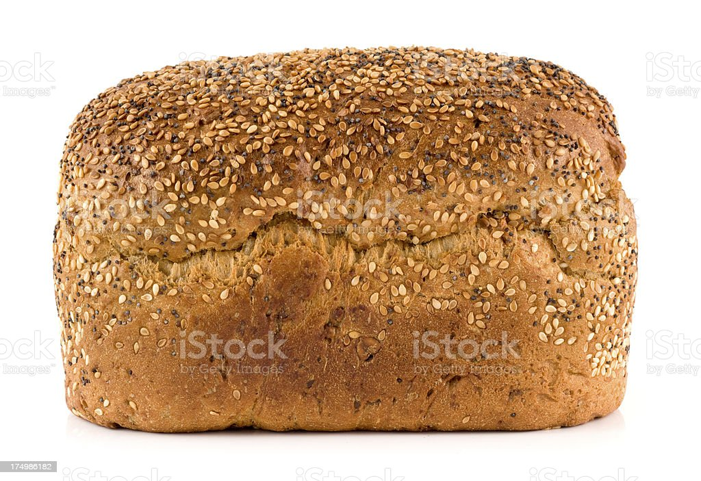 Wholemeal seeded brown bread loaf on a white background stock photo