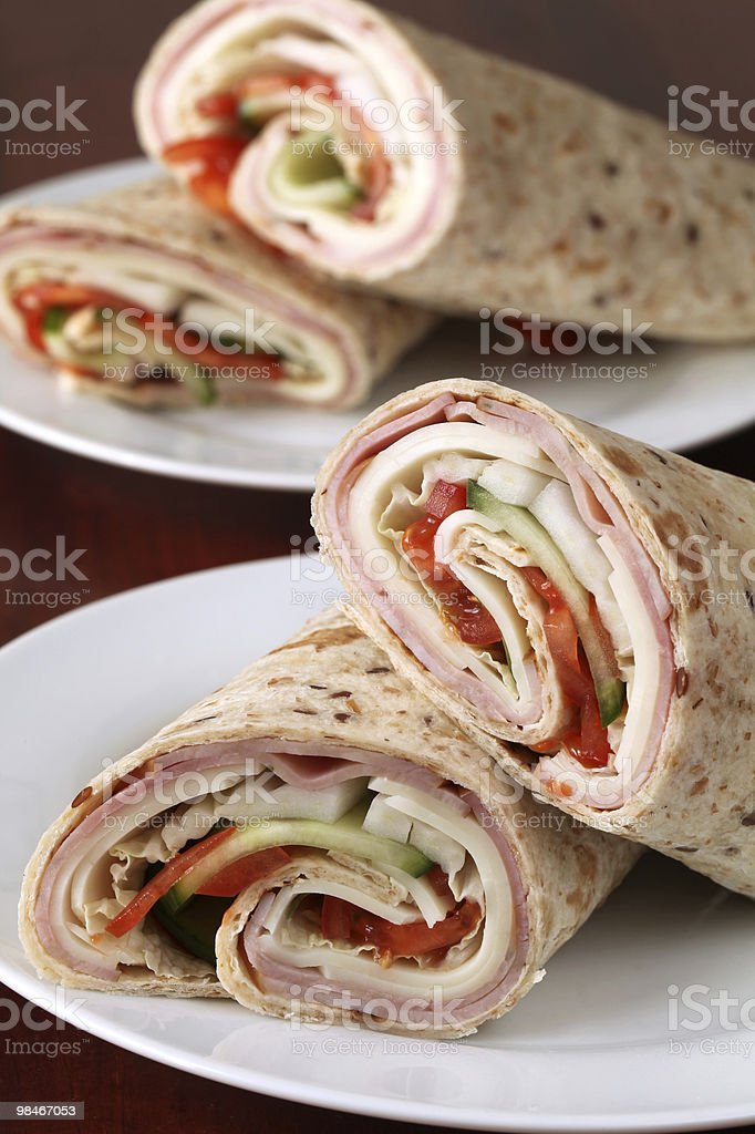 Wholemeal tortillas with ham, cheese and wegetables royalty-free stock photo