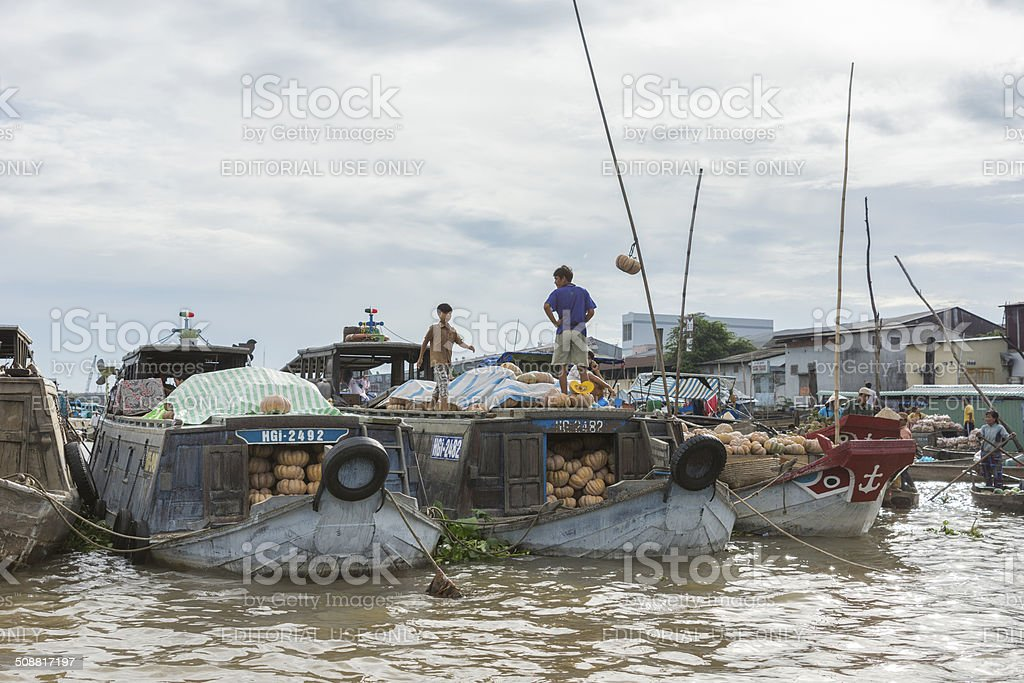 Wholesalers came on larger barges loaded with pumpkins. stock photo