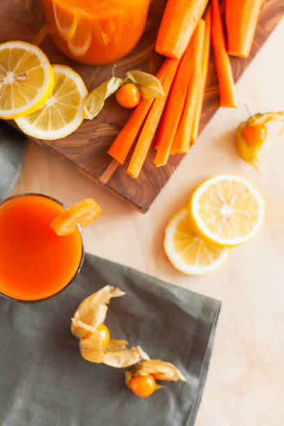 Wholesome carrot juice on rustic table Wholesome carrot juice on rustic table vegetable juice stock pictures, royalty-free photos & images