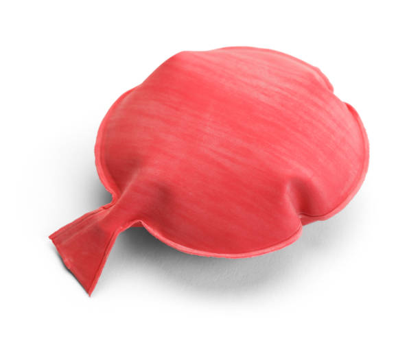 Whoopee Cushion Red Rubber Noise Maker Isolated on a White Background. april fools day stock pictures, royalty-free photos & images