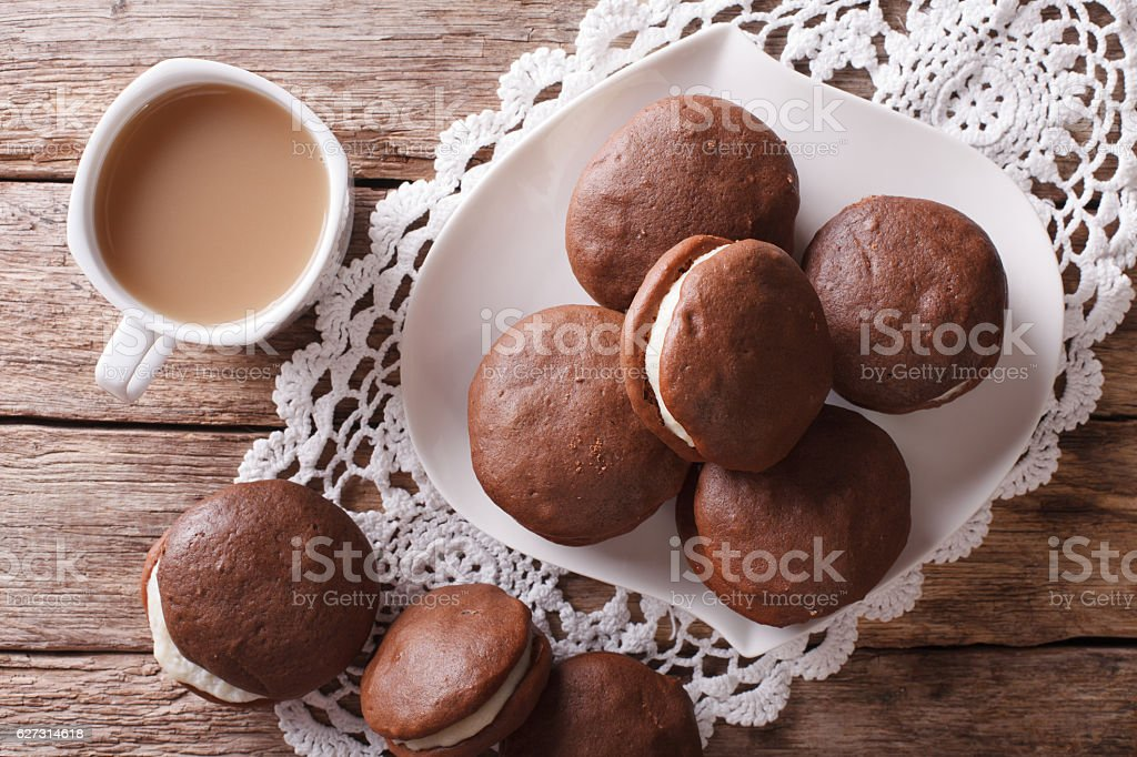 Whoopie pie dessert and coffee close-up on the table. horizontal stock photo