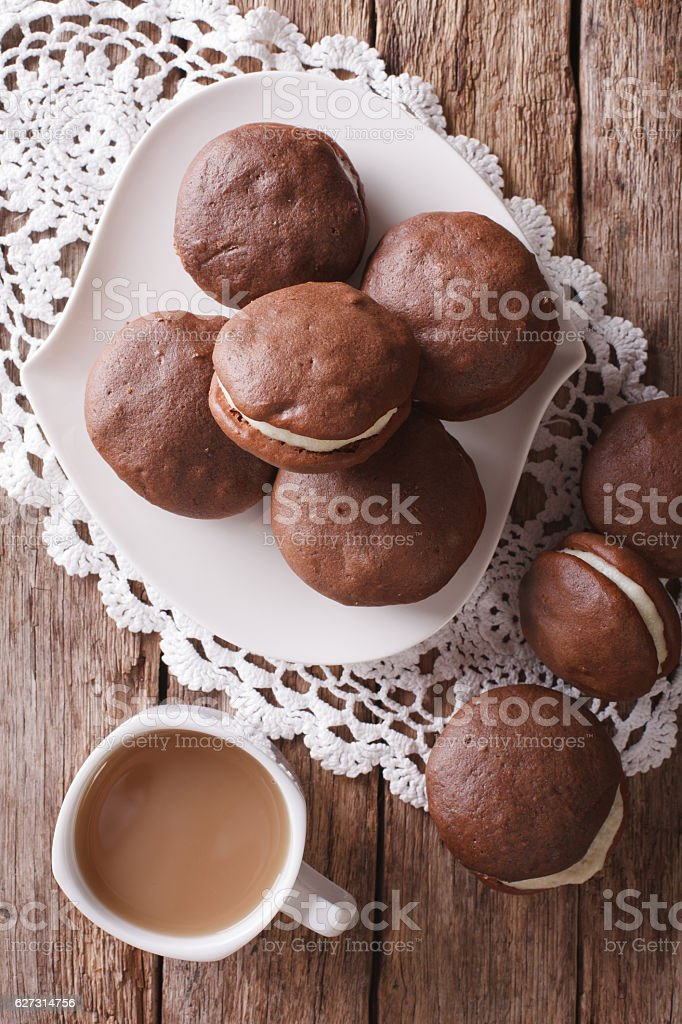 Whoopie pie dessert and coffee close-up on the table. vertical stock photo