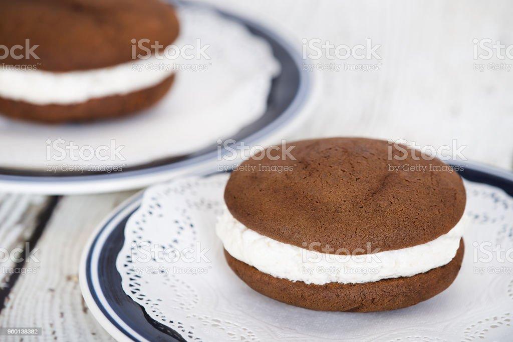 Whoopie pie or moon pie, a chocolate cake dessert stock photo