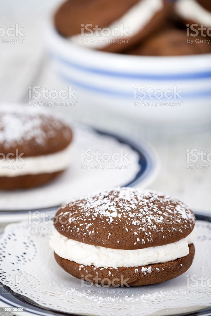 Whoopie pies or moon pies, chocolate cake desserts stock photo