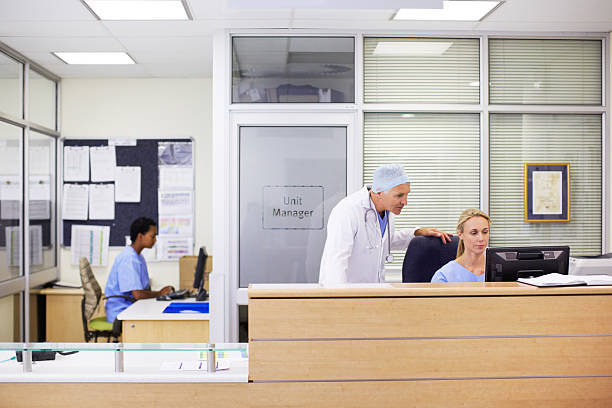 who's my next patient? - receptionist stock photos and pictures