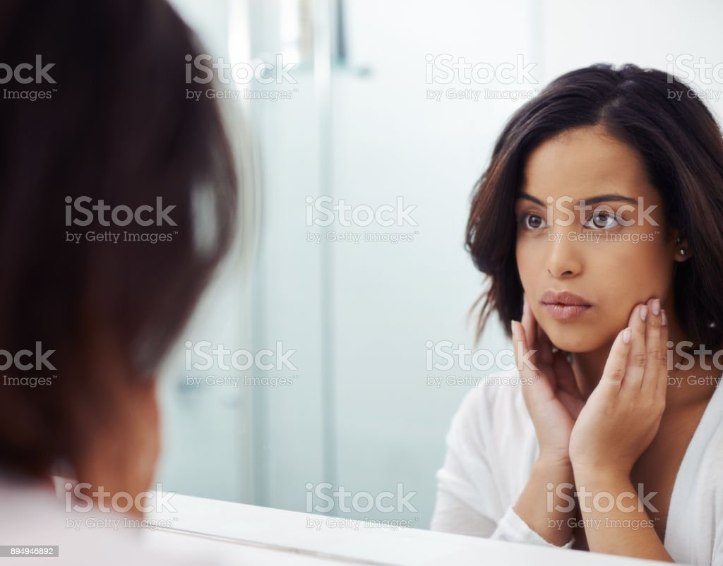 Who's the face staring back at you? stock photo