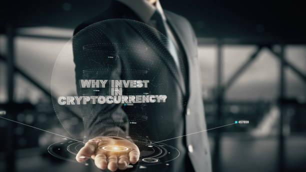 Why Invest in Cryptocurrency_150 with hologram businessman concept stock photo