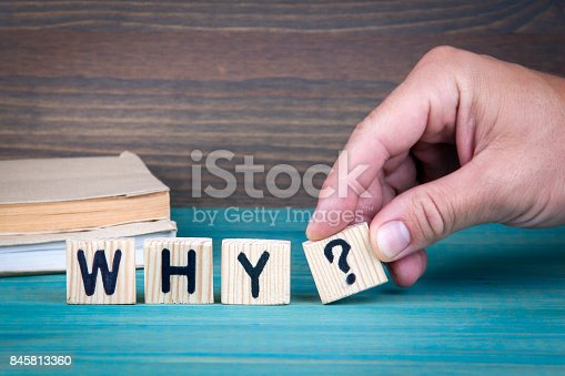 1031235468 istock photo Why. Wooden letters on the office desk 845813360