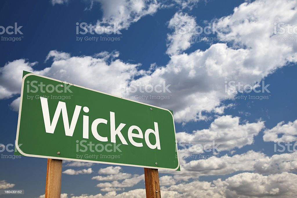 Wicked Green Road Sign with Sky stock photo