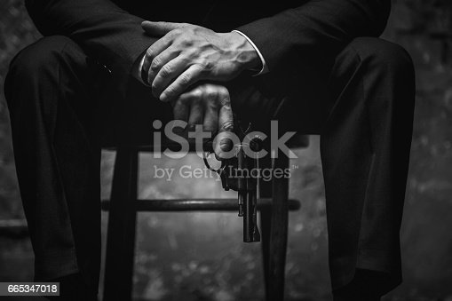 istock Wicked man holding his gun at the ready 665347018