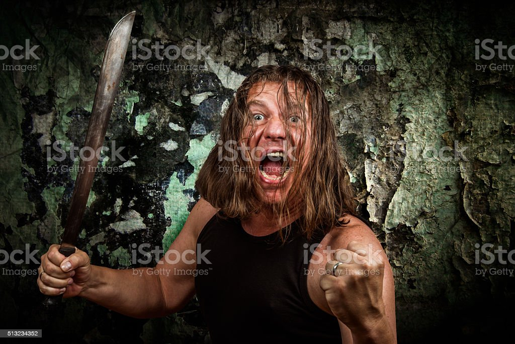 wicked man with machete stock photo