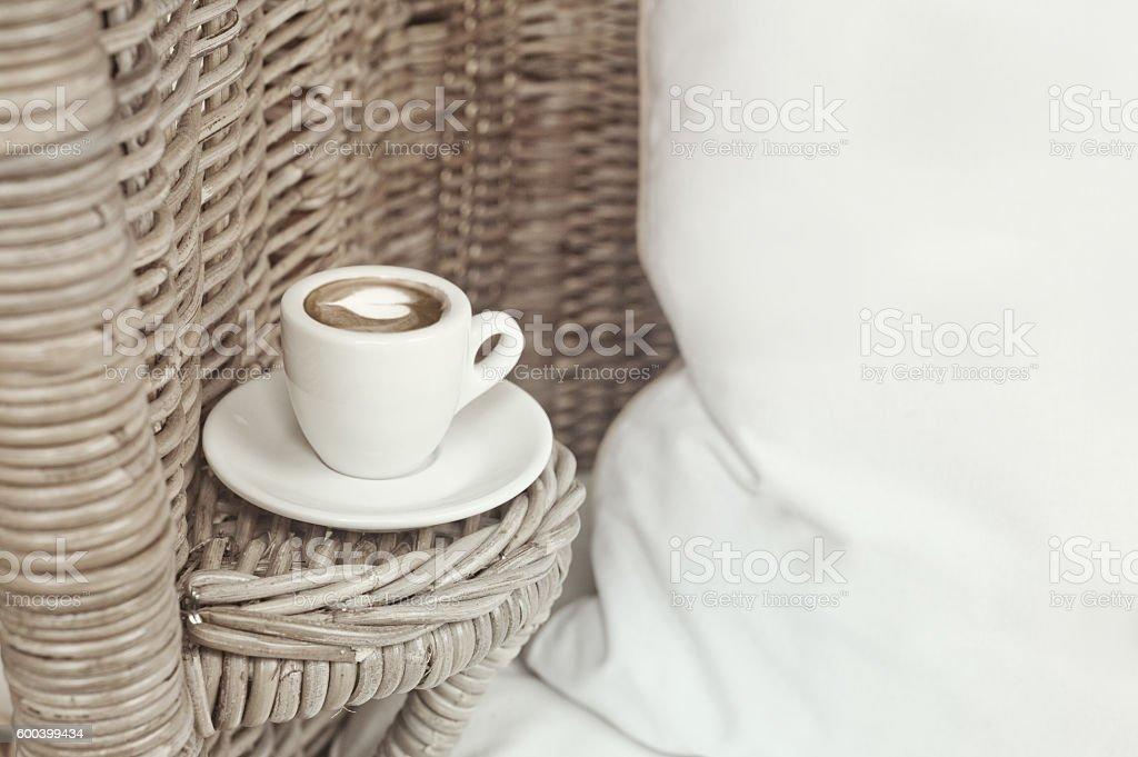 Wicker armchair, white pillow stock photo