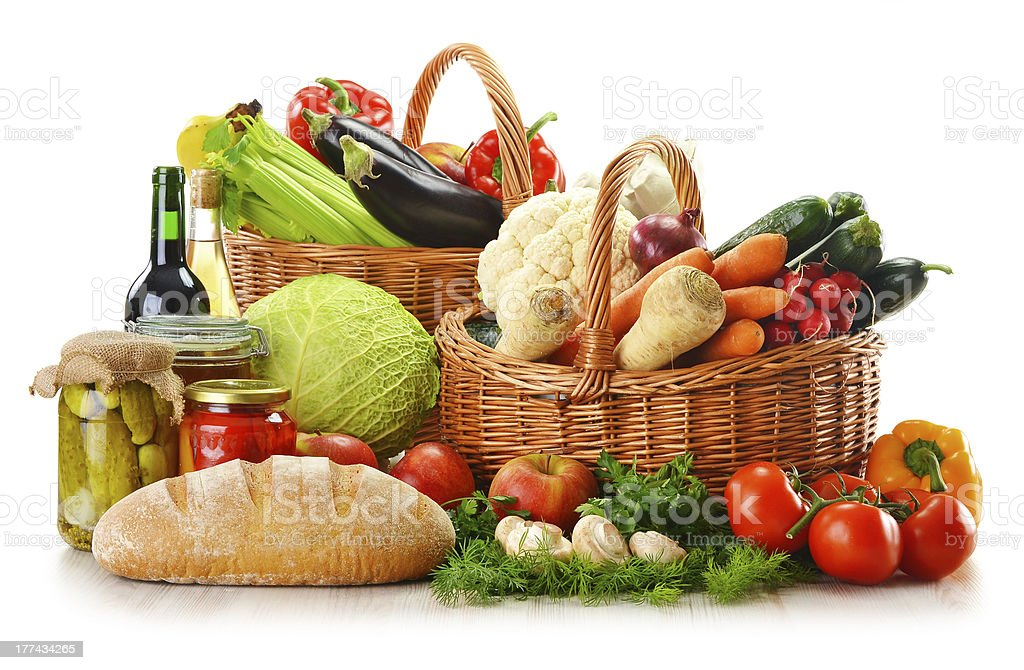 Wicker basket and grocery isolated on white royalty-free stock photo