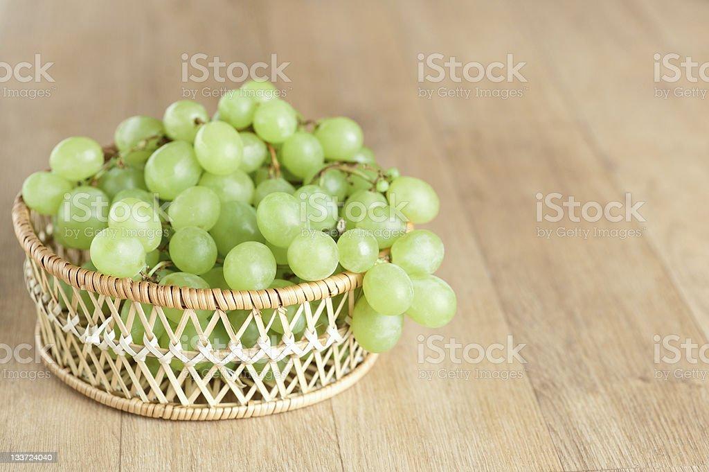wicker basket bunch green grapes closeup royalty-free stock photo