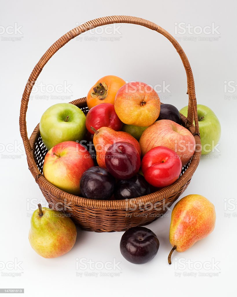 Wicker basket full of fruits royalty-free stock photo