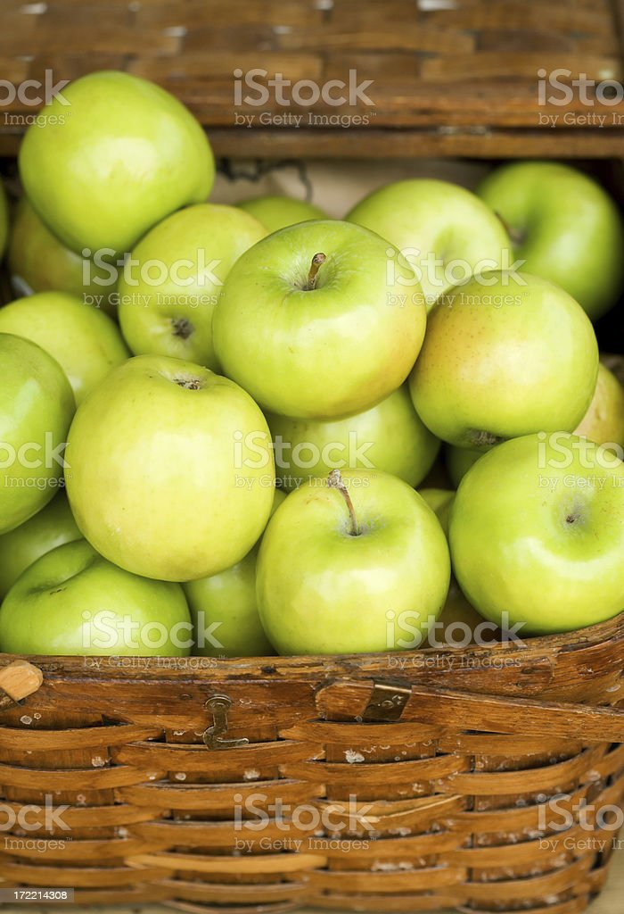 Wicker Basket full of green apples royalty-free stock photo