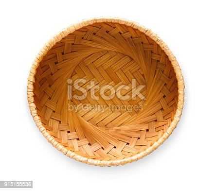 Top view on vintage wicker basket isolated on white background. Weave container for fruits, bread or easter eggs, cutout