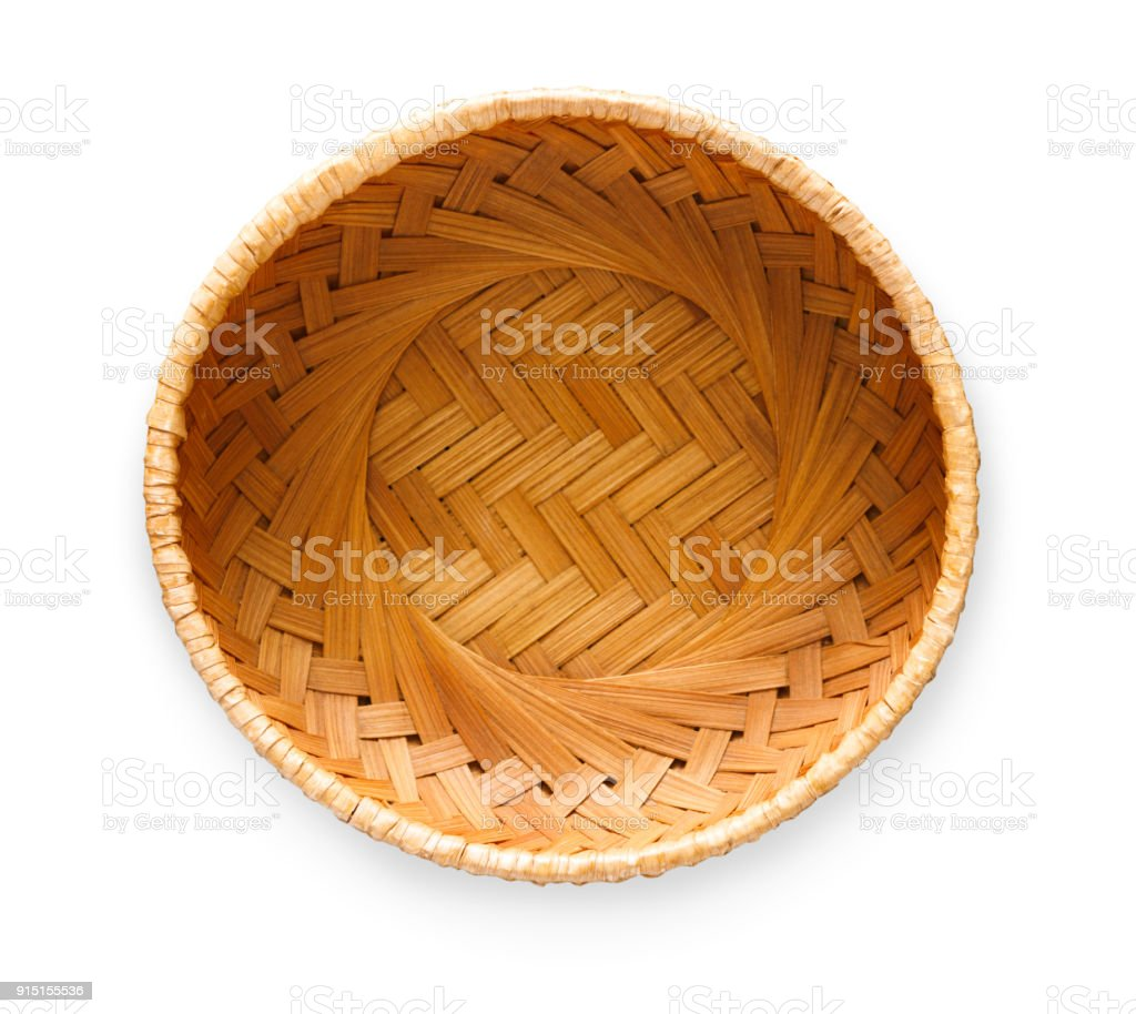 Wicker basket isolated on white background, top view stock photo