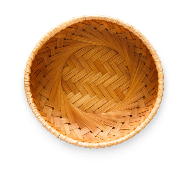 Wicker basket isolated on white background, top view Top view on vintage wicker basket isolated on white background. Weave container for fruits, bread or easter eggs, cutout wicker stock pictures, royalty-free photos & images