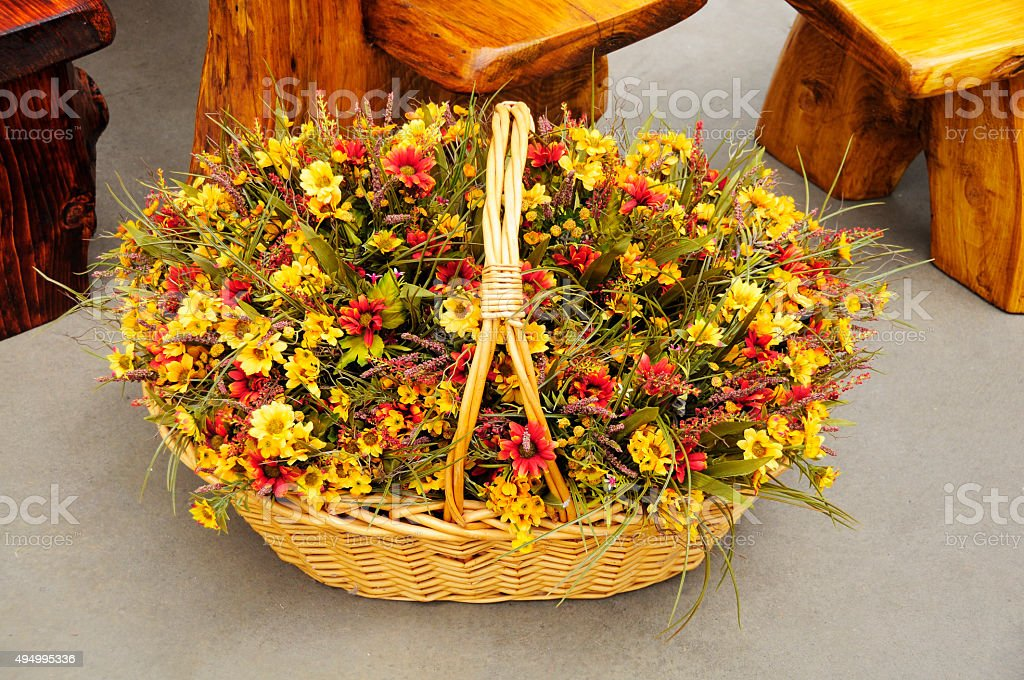 basket of beautiful orange and yellow flowers for the holidays