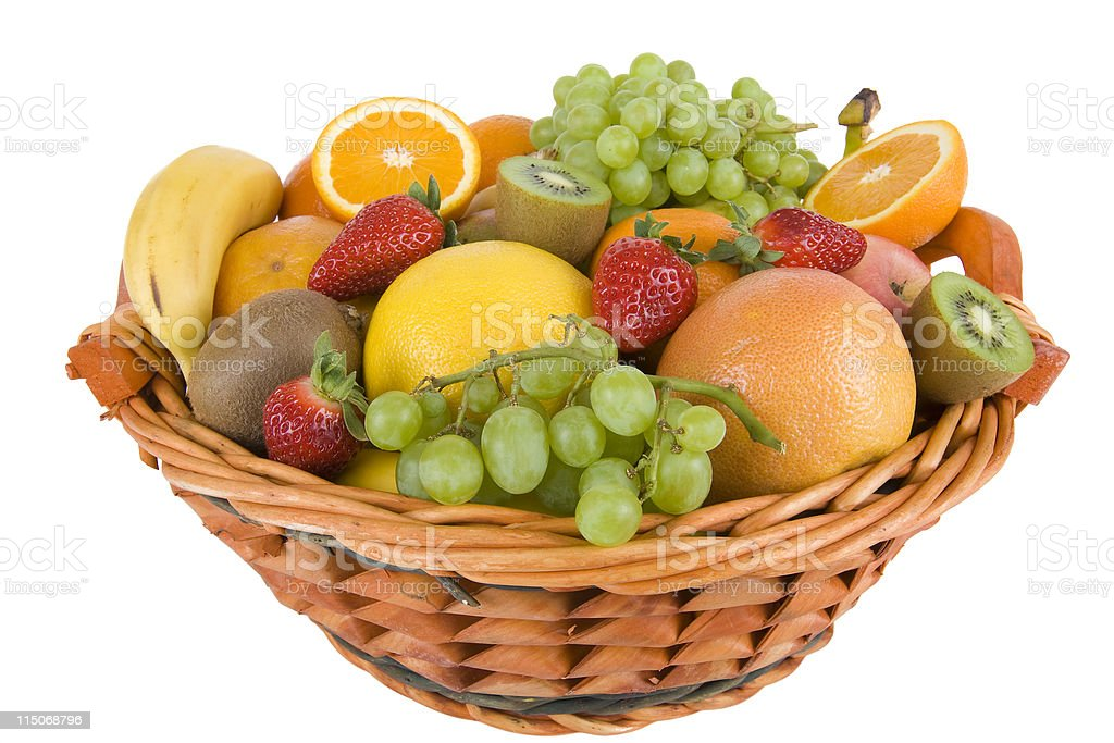 A wicker basket of summer fruits  stock photo