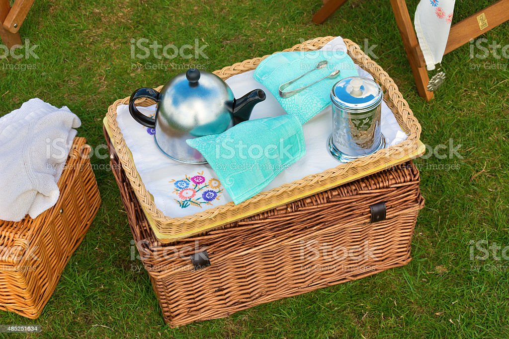 Wicker basket set for afternoon tea stock photo