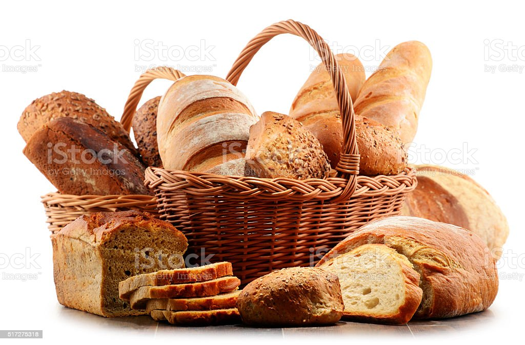 Wicker basket with assorted baking products isolated on white stock photo